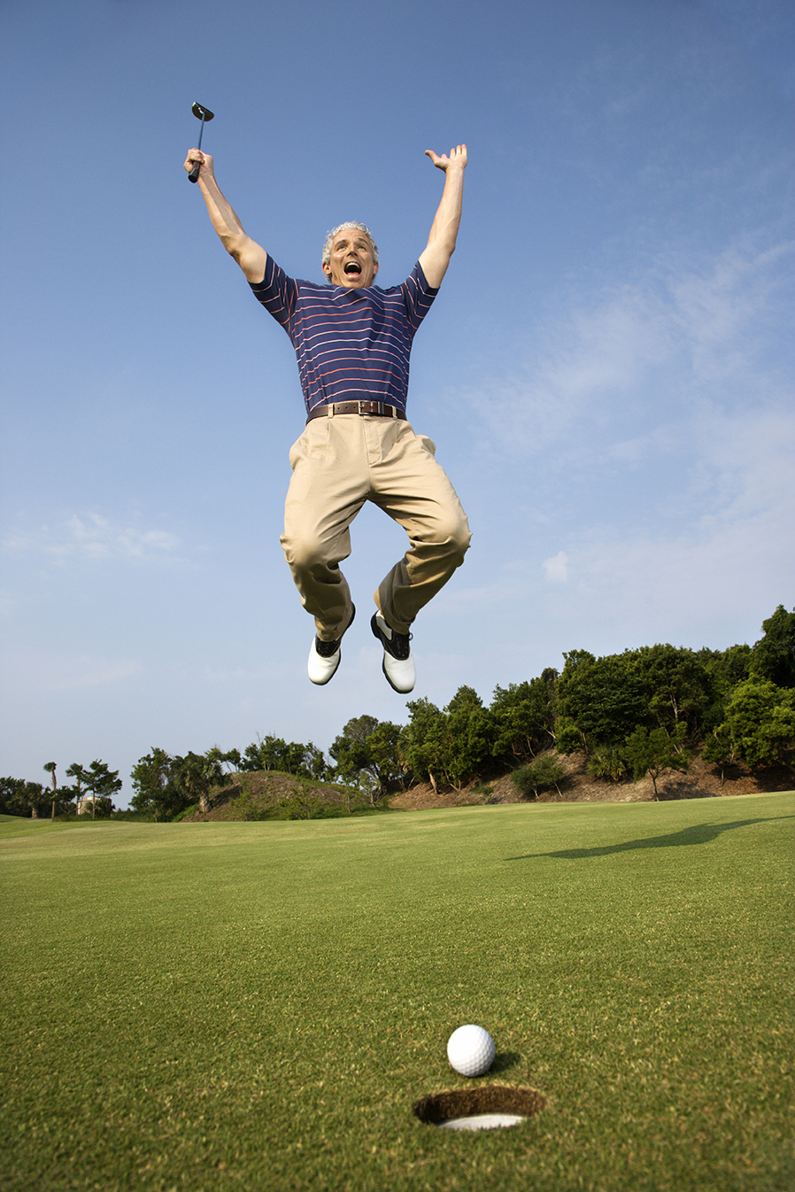 Pin High - jumping golfer